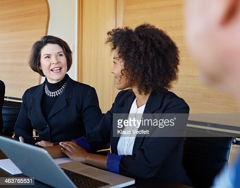 Coworkers talking at meeting : Stock Photo