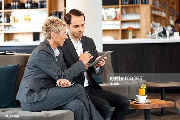 Coworkers Using Digital Tablet