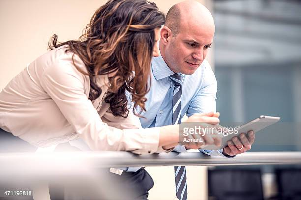 Coworkers with digital tablet