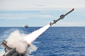 USS Cowpens launches a Harpoon missile from the aft missile deck.