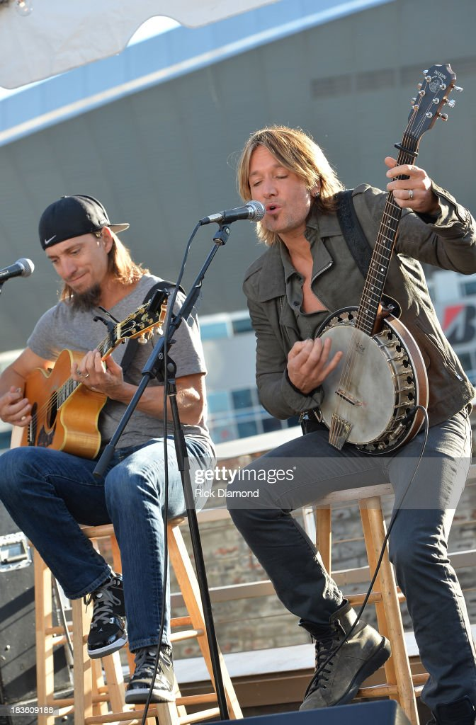 Co-writer Brad Warren with Keith Urban perform as Keith Urban, BMI & ASCAP Celebrate the No. 1 Song 'Little Bit Of Everything' at Aerial In Nashville on October 7, 2013 in Nashville, United States.