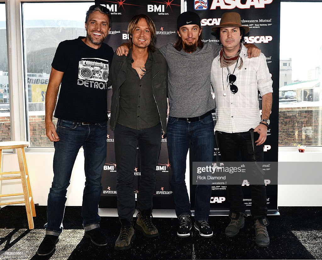 Co-writer Brett Warren, <a gi-track='captionPersonalityLinkClicked' href=/galleries/search?phrase=Keith+Urban&family=editorial&specificpeople=202997 ng-click='$event.stopPropagation()'>Keith Urban</a>, co-writers Brad Warren and Kevin Rudolf are honored as BMI & ASCAP Celebrates the No.1 Song 'Little Bit Of Everything' at Aerial In Nashville on October 7, 2013 in Nashville, United States.
