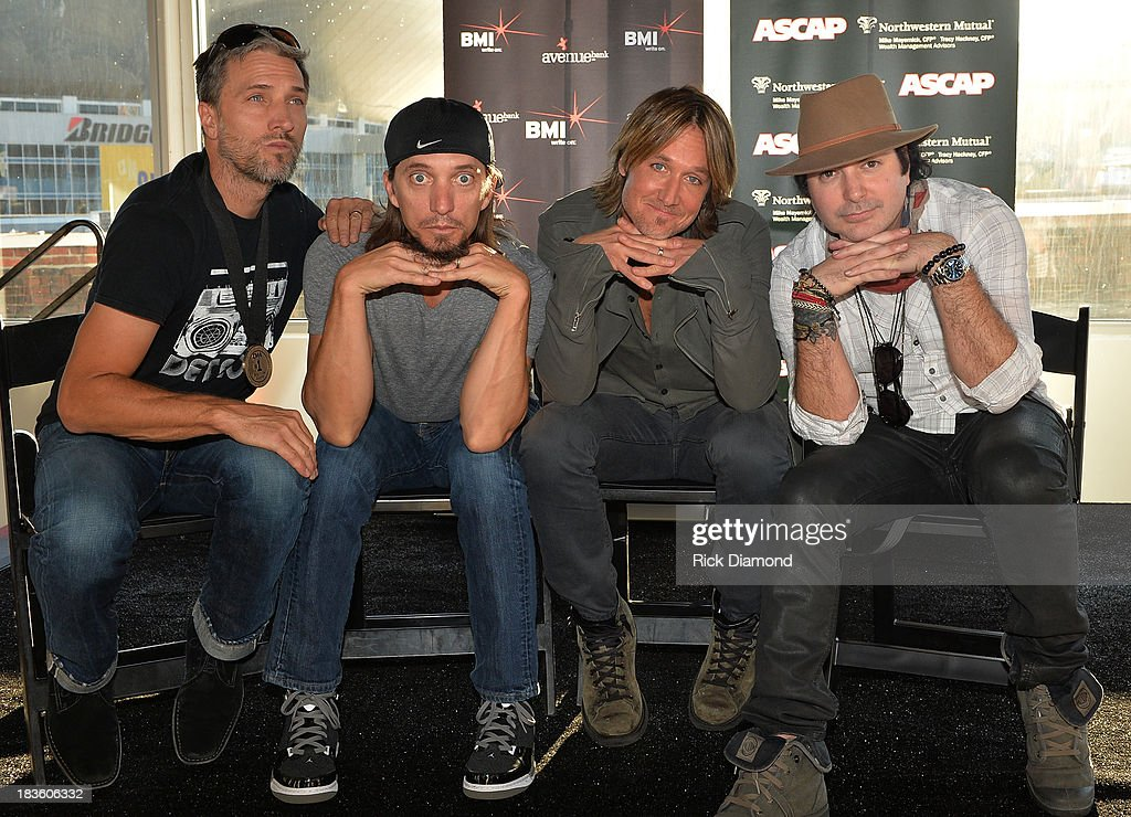 Co-writer Brett Warren, Keith Urban, co-writers Brad Warren and Kevin Rudolf are honored as BMI & ASCAP Celebrate the No.1 Song 'Little Bit Of Everything' at Aerial In Nashville on October 7, 2013 in Nashville, United States.