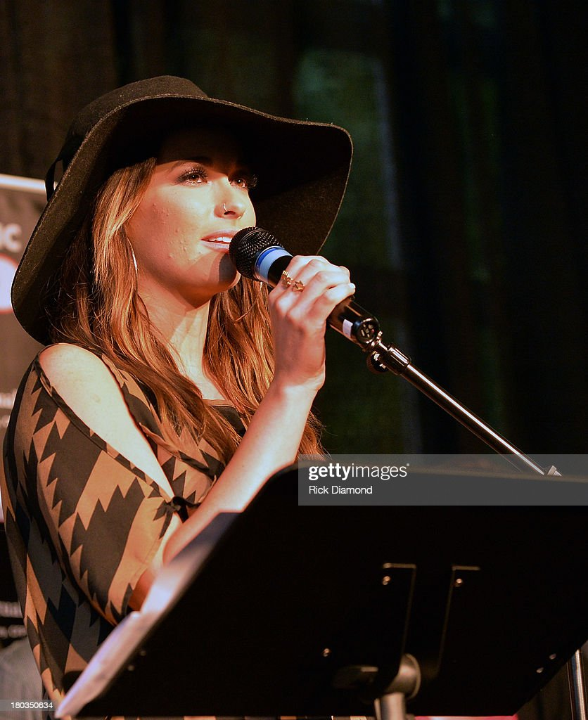 Co-Writer Kasey Musgraves addresses the invited guests and media during the Celebration of <a gi-track='captionPersonalityLinkClicked' href=/galleries/search?phrase=Miranda+Lambert&family=editorial&specificpeople=571972 ng-click='$event.stopPropagation()'>Miranda Lambert</a>'s No.1 Song 'Mama's Broken Heart' with co writers Kacey Musgraves, Brandy Clark and Shane McAnally performed by <a gi-track='captionPersonalityLinkClicked' href=/galleries/search?phrase=Miranda+Lambert&family=editorial&specificpeople=571972 ng-click='$event.stopPropagation()'>Miranda Lambert</a> at Cabana on September 11, 2013 in Nashville, Tennessee.