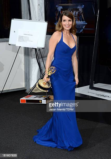 CoWriter Tina Fey winner of Best Writing for a Comedy Series Award for '30 Rock' poses in the press room during the 65th Annual Primetime Emmy Awards...