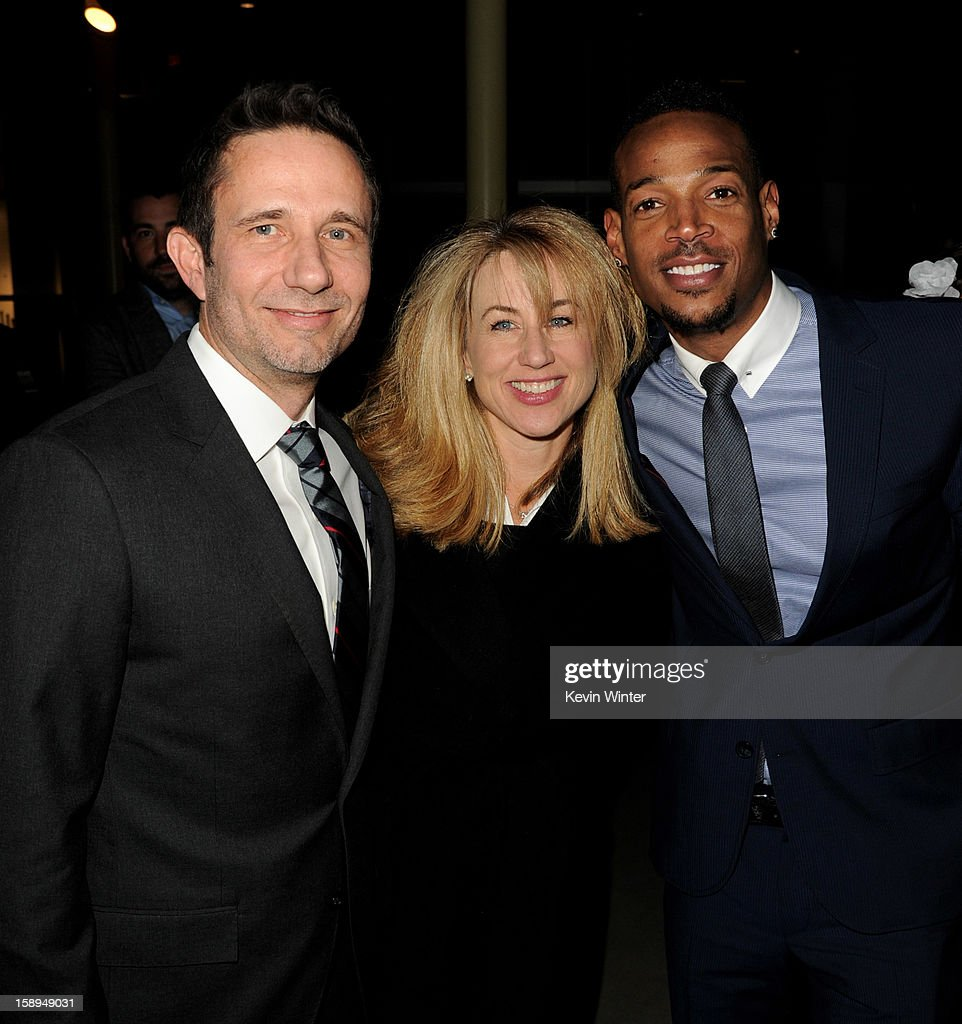 Co-writer/producer Rick Alvarez, executive producer Lisa Blum and co-writer/producer/actor Marlon Wayans arrive at the premiere of Open Road Films' 'A Haunted House' at the Arclight Theatre on January 3, 2013 in Los Angeles, California.