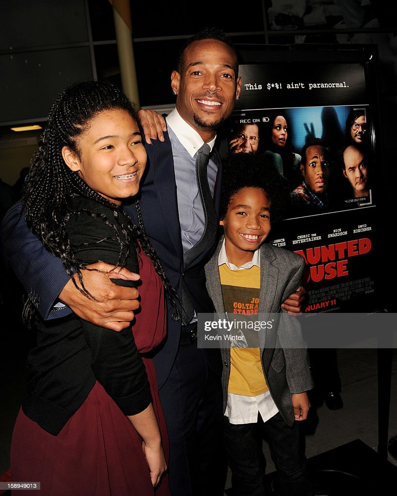 Co-writer/producer/actor Marlon Wayans (C) and his daughter Amai and son Shawn pose at the premiere of Open Road Films' 'A Haunted House' at the Arclight Theatre on January 3, 2013 in Los Angeles, California.