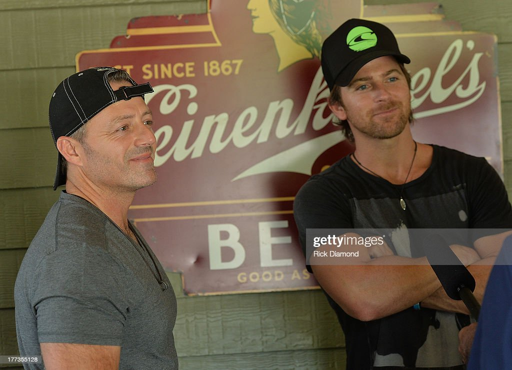 CoWriters Dan Couch and Kip Moore celebrate during the BMI Party For 'Hey Pretty Girl' By Kip Moore at Flying Saucer Draught Emporium on August 22...