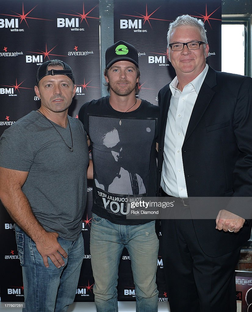 Co-Writers Dan Couch Singer/Songwriter <a gi-track='captionPersonalityLinkClicked' href=/galleries/search?phrase=Kip+Moore&family=editorial&specificpeople=8375431 ng-click='$event.stopPropagation()'>Kip Moore</a> and BMI's Perry Howard attend the BMI #1 Party For 'Hey Pretty Girl' By <a gi-track='captionPersonalityLinkClicked' href=/galleries/search?phrase=Kip+Moore&family=editorial&specificpeople=8375431 ng-click='$event.stopPropagation()'>Kip Moore</a> at Flying Saucer Draught Emporium on August 22, 2013 in Nashville, Tennessee.