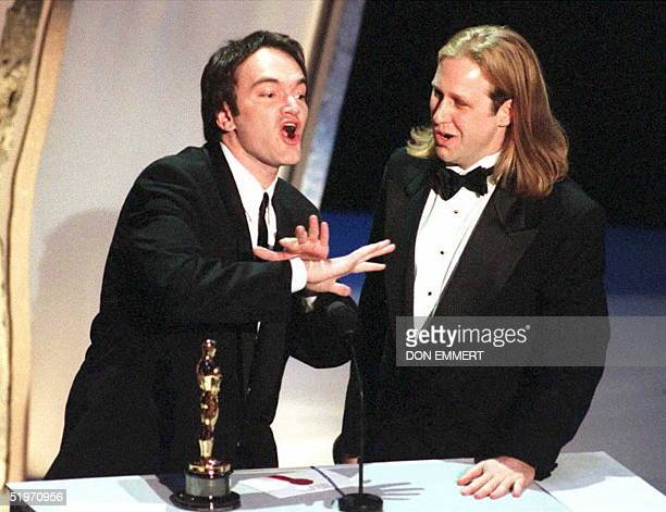 Cowriters Quentin Tarantino and Roger Avary accept the Oscar award for best original screenplay for the film 'Pulp Fiction' at the 67th Annual...