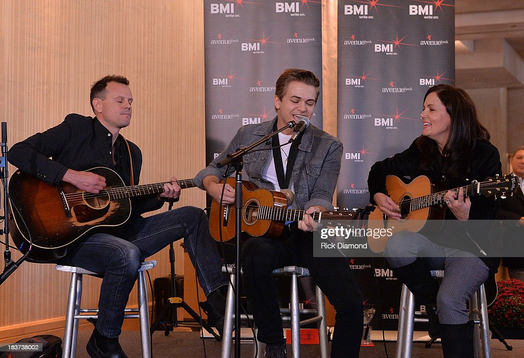 Co-writers Troy Verges, <a gi-track='captionPersonalityLinkClicked' href=/galleries/search?phrase=Hunter+Hayes&family=editorial&specificpeople=3290701 ng-click='$event.stopPropagation()'>Hunter Hayes</a> and co-writer Lori McKenna perform during the BMI and <a gi-track='captionPersonalityLinkClicked' href=/galleries/search?phrase=Hunter+Hayes&family=editorial&specificpeople=3290701 ng-click='$event.stopPropagation()'>Hunter Hayes</a> Celebration of their No. 1 Song 'I Want Crazy' at BMI offices In Nashville on October 8, 2013 in Nashville, Tennessee.