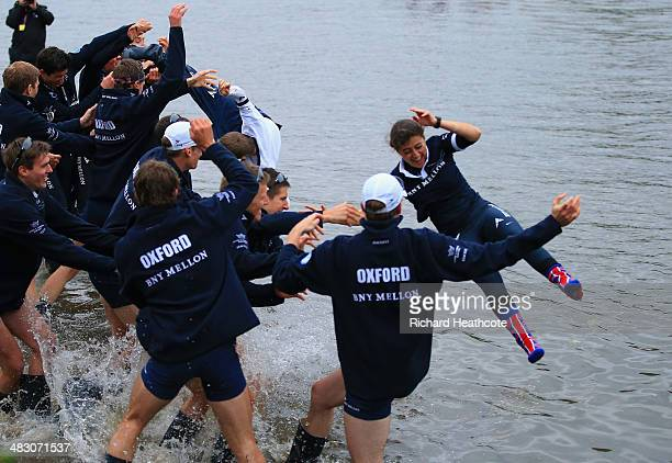 Cox Sophie Shawdon of Isis IS thrown into the Thames by her crew after victory during the BNY Mellon 160th Oxford versus Cambridge University Boat...