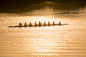 Coxed eight team sweep rowing