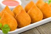Coxinha de Galinha - Brazilian deep fried chicken snack, popular at local parties. Served with chili sauce.