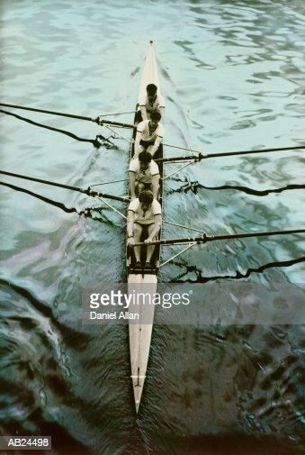 Coxless four rowing in racing shell, elevated view : Stock Photo
