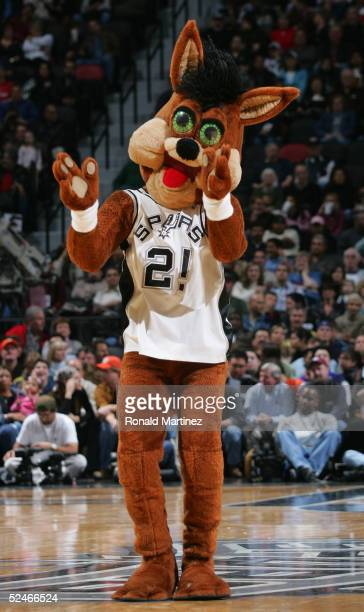 Coyote the San Antonio Spurs mascot claps during the game against the Philadelphia 76ers on December 1 2004 at the SBC Center in San Antonio Texas...