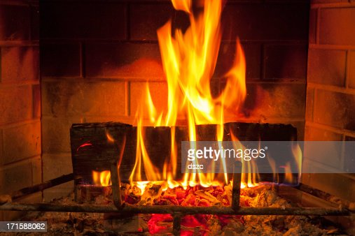 cozy blazing fire in fireplace
