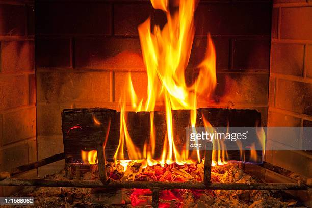 cozy blazing fire in fireplace