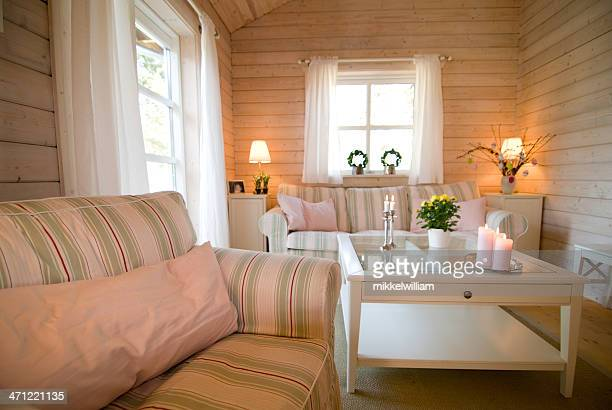 Cozy living room scandinavian style with walls made of wood