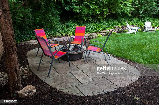 Cozy seating around a fire pit is photographed in the Andelman's backyard Wednesday June 19 2013 in Arlington VA Jason Andelman a chocolatier who...
