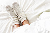 Warm and cozy white socks in the bed