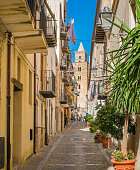 A cozy street in Cefalù, rich with details and colors. Sicily, southern Italy.