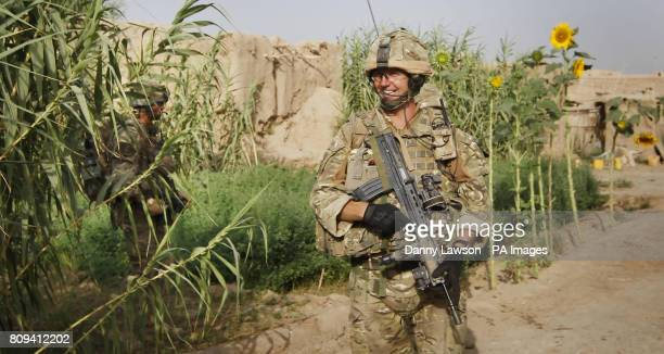Cpl Alan Hiddleston of XRay Company 45 Commando Royal Marines in the village of Siadabad while on patrol from Patrol Base Kalang in Afghanistan