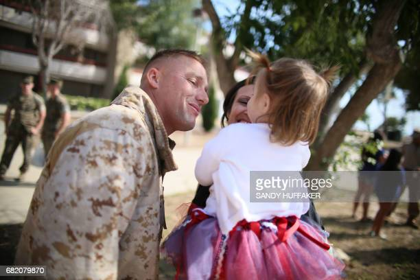 Cpl Cade Copeland shares a moment with his daughter Canee Copeland during a homecoming reception at Camp Pendleton in Oceanside California on May 11...