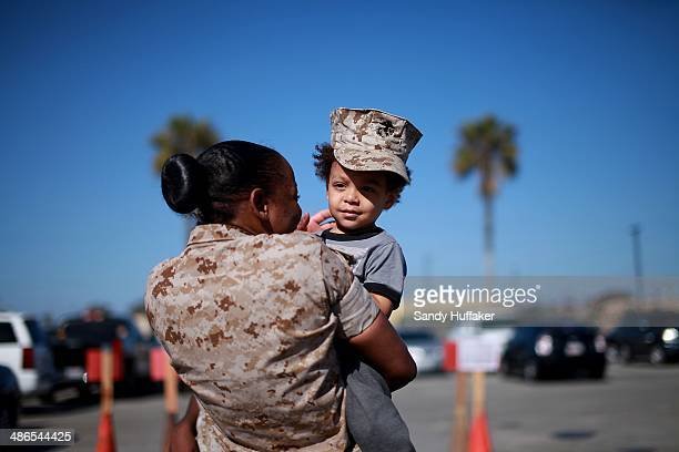 Cpl Samantha Grant holds her friends son Kaiden Helms during a homecoming at Del Mar Beach on April 24 2014 in Camp Pendleton California...