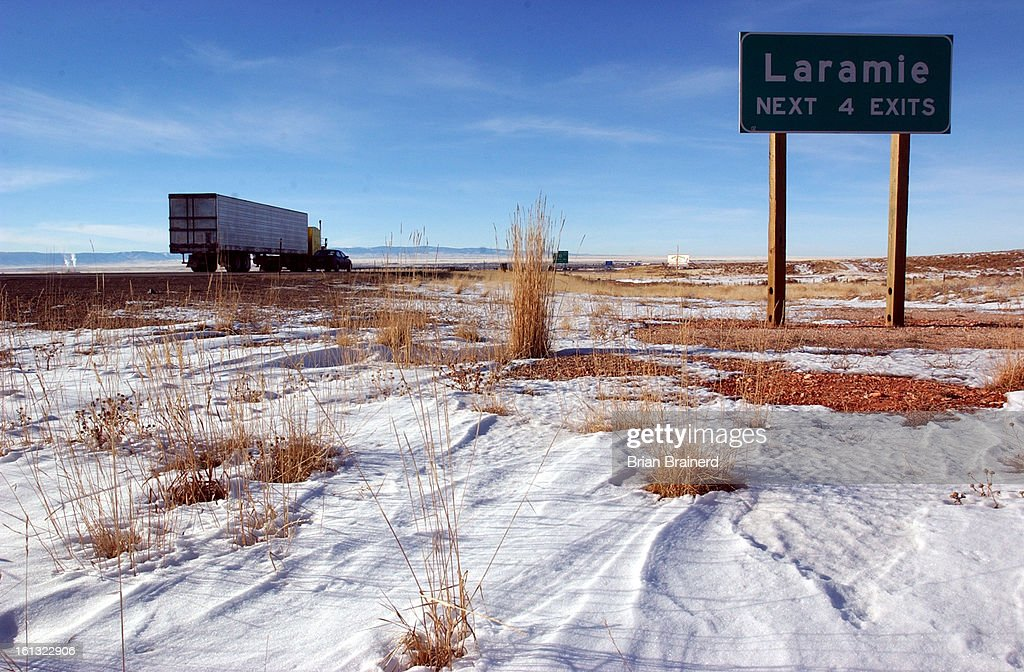 LARAMIE WYO DEC 18 2003 <cq> Interstate 80 west bound into Laramie Wyoming is the most sparsely populated hightech state was one of only three states...