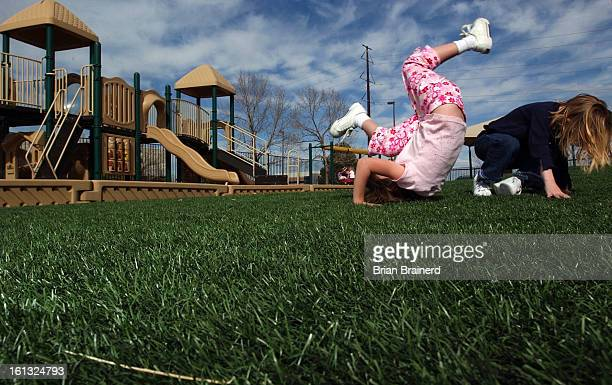 RANCH CO MAR 22 2004 <cq> Preschoolers play on artificial turf Primrose School of Highlands Ranch Business Park replaced natural grass in the play...