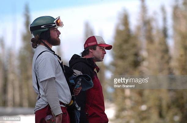 PASS COLORADO NOVEMBER 6 2005<cq> Two young men watch as fire and rescue personel remove the body of their skiing companion killed in an avalanche...