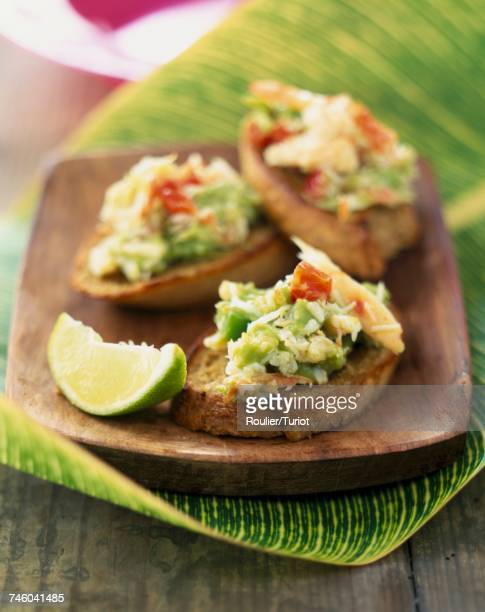 Crab and avocado toasts