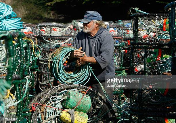 Crab fisherman Bob Longstreath reapairs his crab traps in the parking lot of the Pillar Point Harbor Novemeber 15 2007 in Princeton By The Sea...