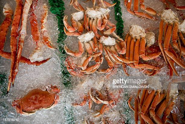 Crab is seen on ice at Jessie Taylor Seafood July 1 2012 in Washington DC Utility crews made slow progress Sunday in restoring electricity to...