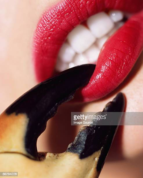 Crab pinching woman's lip