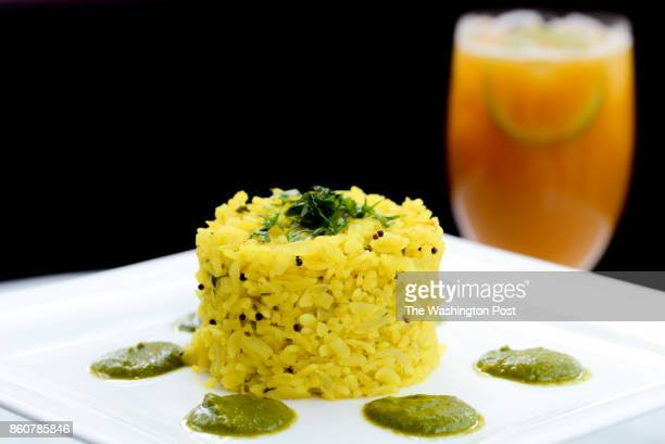 Crab Poha Pressed rice mustard seeds curry leaves and coconut chutney with a Mango Mocktail in background at Rasika West End