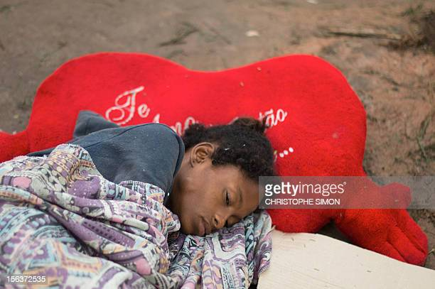 A crack addict sleeps in the streets in the surroundings of Parque Uniao slum in Rio de Janeiro Brazil as social workers and the police carry out an...