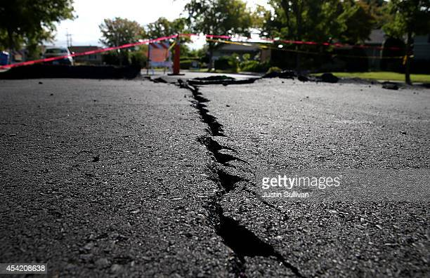 A crack runs down the center of an earthquakedamaged street on August 26 2014 in Napa California Two days after a 60 earthquake rocked the Napa...