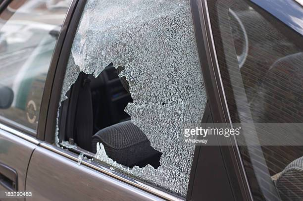 Thief broken glass in car window