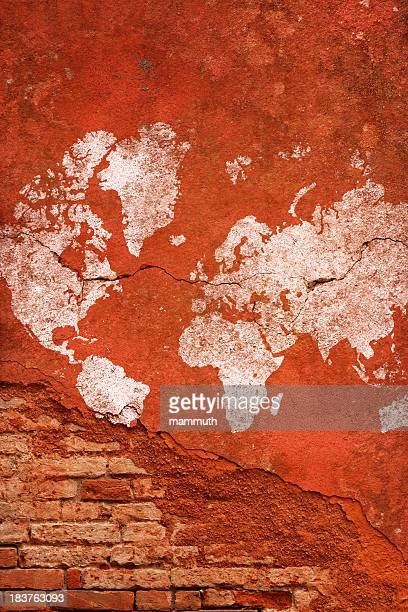 cracked and damaged world map on brick wall
