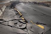 cracked asphalt after earthquake