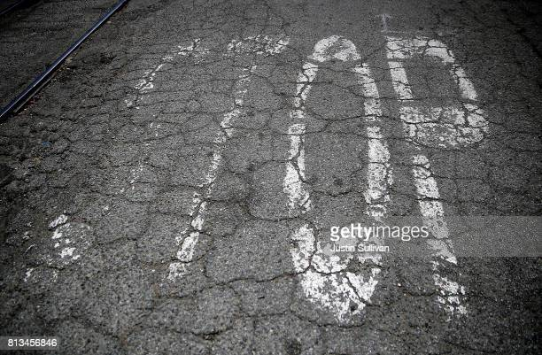 Cracked asphalt is visible at an intersection on 20th Street on July 12 2017 in Oakland California According to a report by WalletHub roads in San...