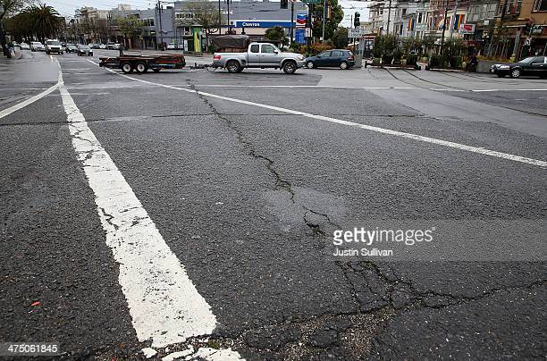 Cracked asphalt is visible at an intersection on February 26 2014 in San Francisco California During a visit to St Paul Minnesota US President Barack...