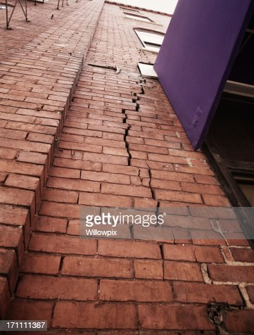 Cracked Brick Wall Stock Photo Getty Images
