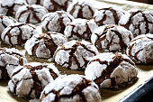 Baked chocolate crackle cookies sprinkled with sugar in the pan