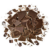 Cracked chocolate pile and curls pile from top on white background