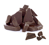 Cracked chocolate pile on white background