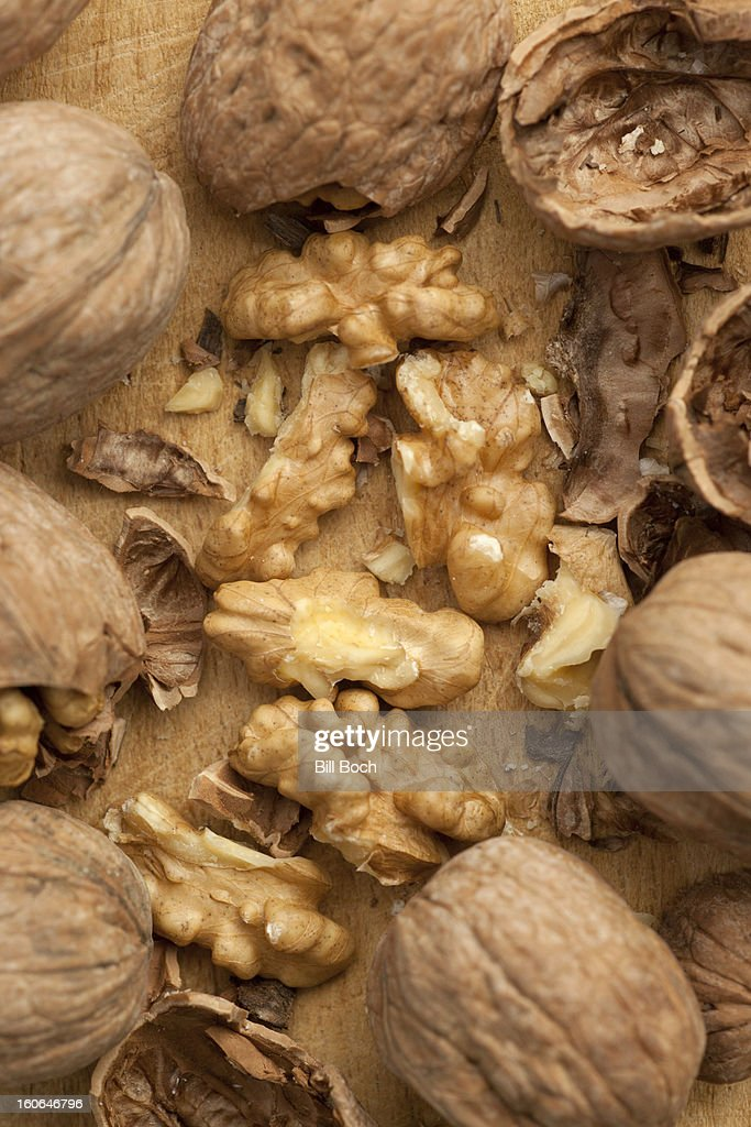 Cracked walnuts close-up : Stock Photo