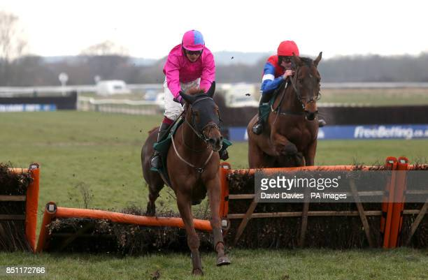 Crackerjack ridden by James Banks jumps ahead of High Ville ridden by Tom Bellamy during the Thwaites Novices' Hurdle